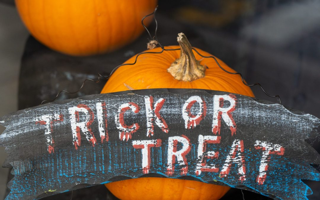 """A sign on Halloween pumpkins that says """"Trick or Treat"""""""