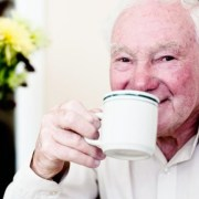 Elderly man drinking tea