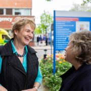 Board member talking to member of the public
