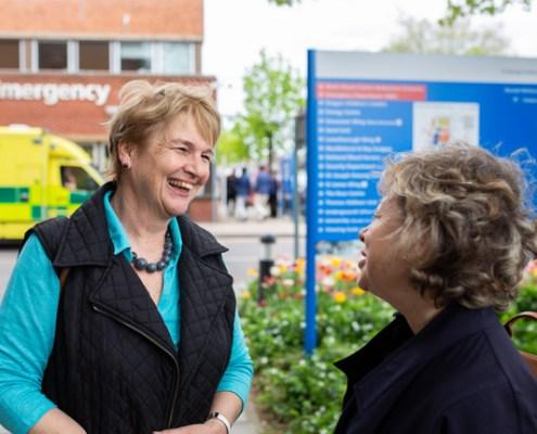 Board member talking to member of the public
