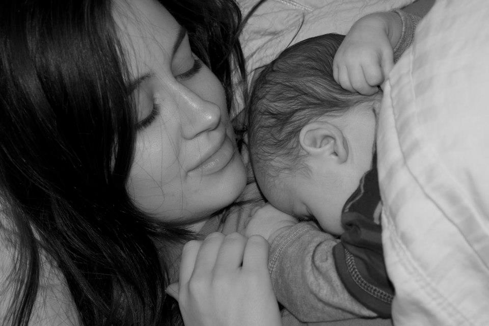 Mom and baby sleeping - how to treat a cold by getting extra sleep.