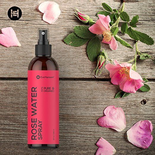 Spray bottle filled with rose water surrounded by rose petals - natural beauty tips (scent)