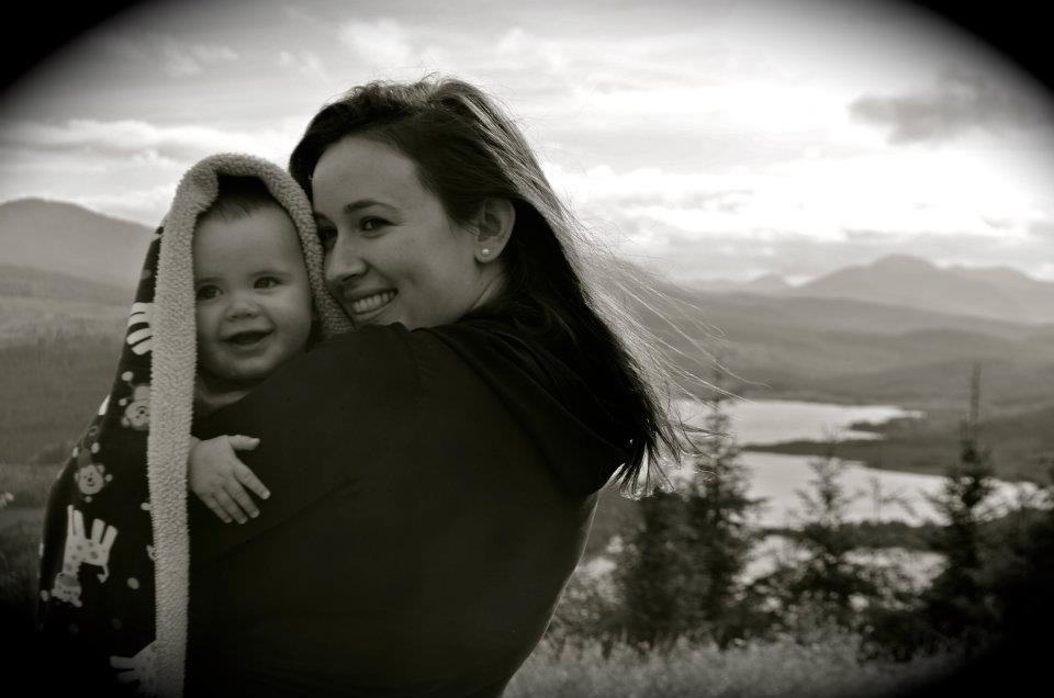 Bible verses about mothers - a black and white photo of a mother holding a baby in an outdoor scene.