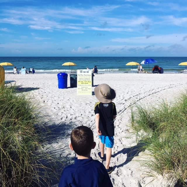 Kids walking to the ocean to swim - vacation activities for kids