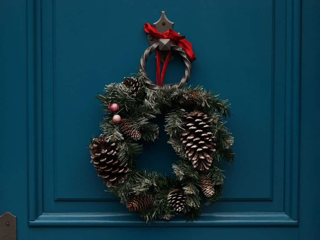 Old fashioned Christmas wreath on a blue front door.