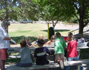 A free children's arts and science program is offered in Silver City's shady park each summer