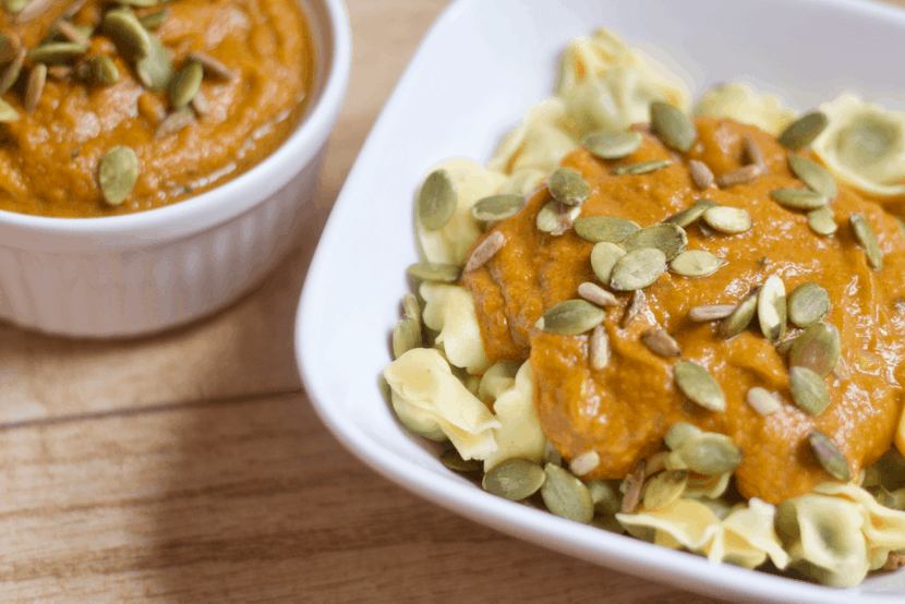 Sweet n' Spicy Pumpkin Sauce with Spinach Tortellini | Healthy Helper @Healthy_Helper A creamy, seasonal sauce with subtle sweetness and lots of spice! This Sweet n' Spicy Pumpkin Sauce is vegan, gluten-free, and filled with flavorful herbs and spices. Paired with crave-worthy tortellini, you have a meal that's fit for fall!