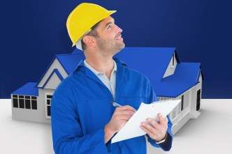 healthy home checklist - supervisor looking up while writing on clipboard