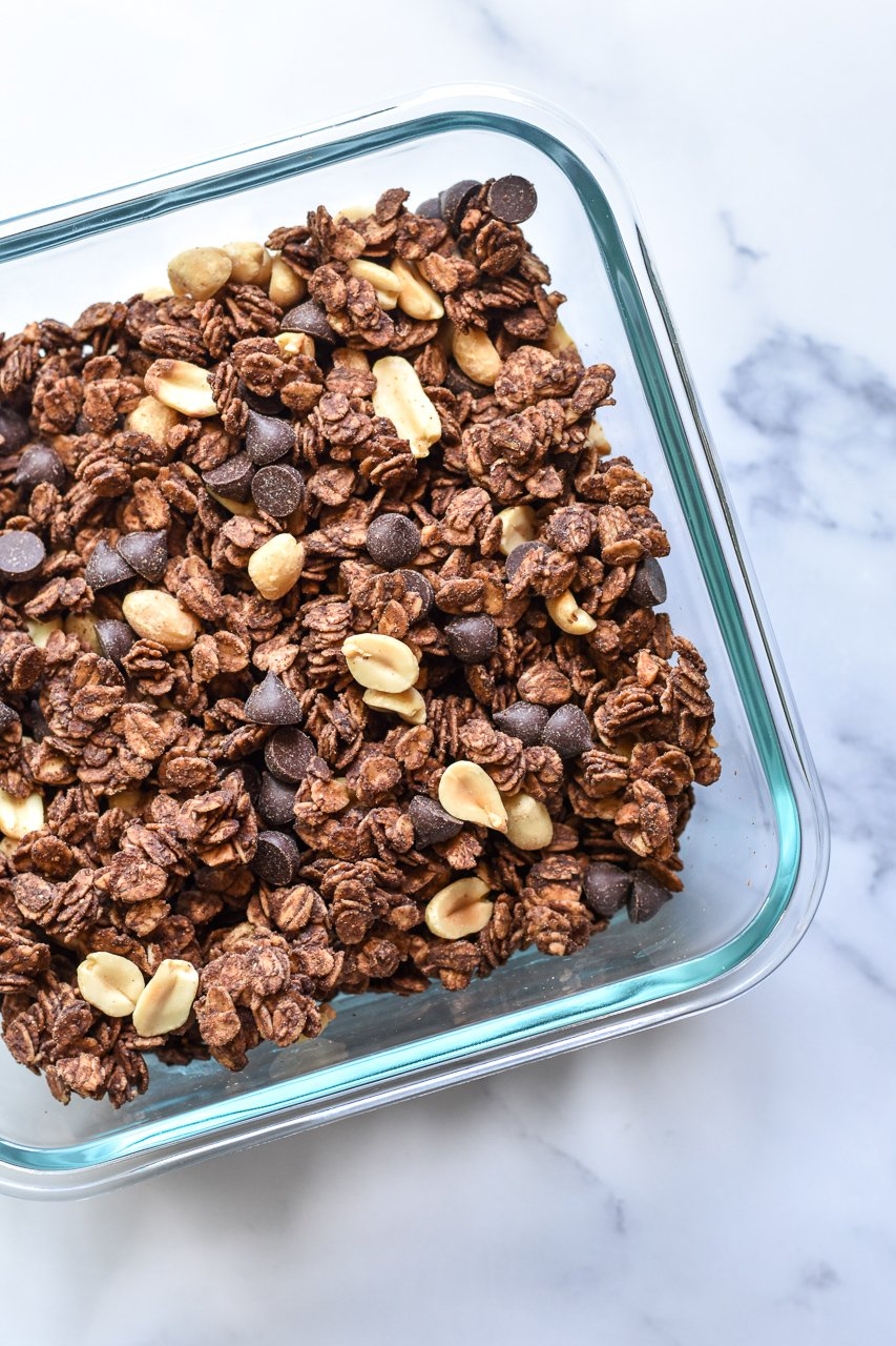 chocolate peanut butter granola in a glass container