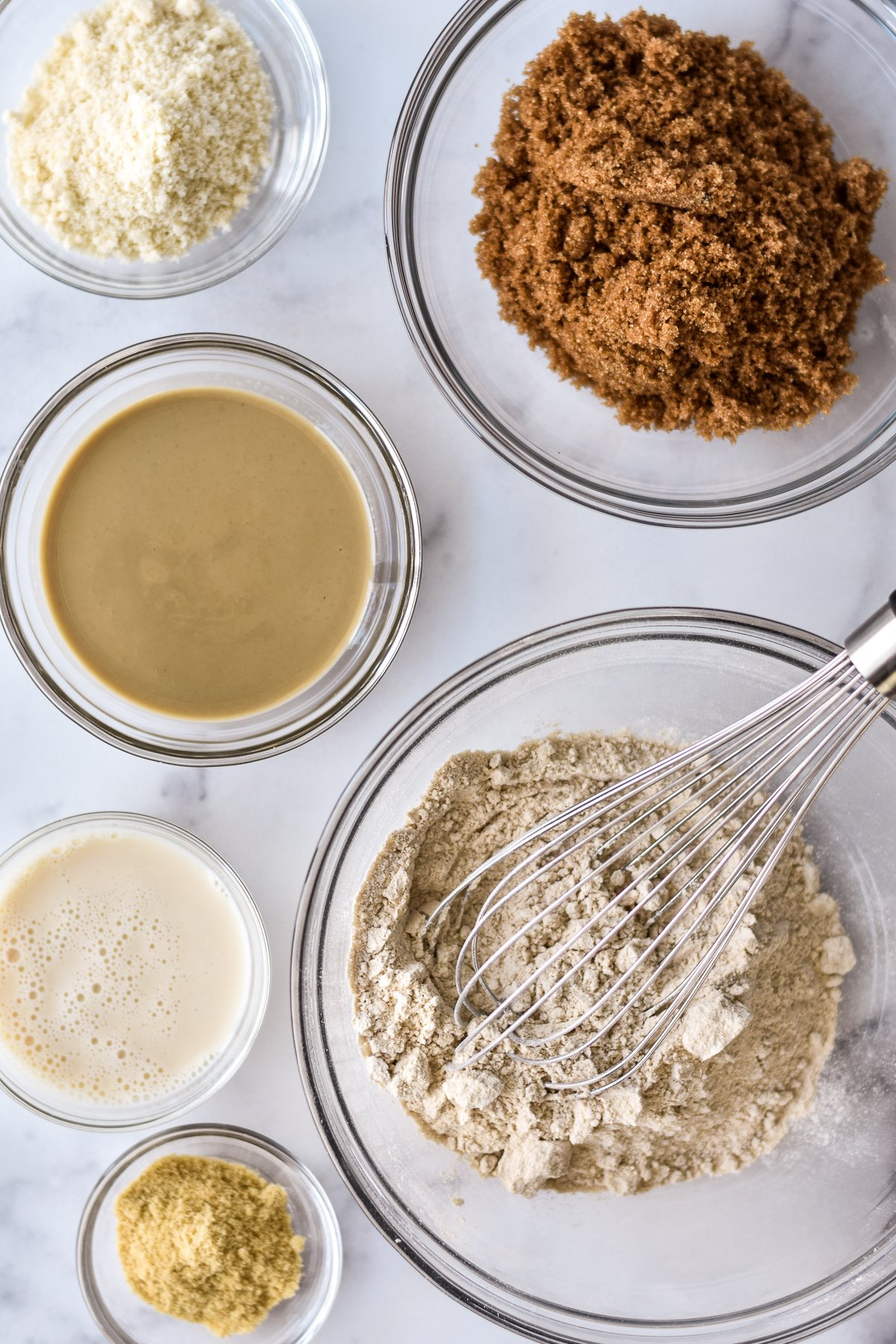 ingredients for vegan blondies with a whisk