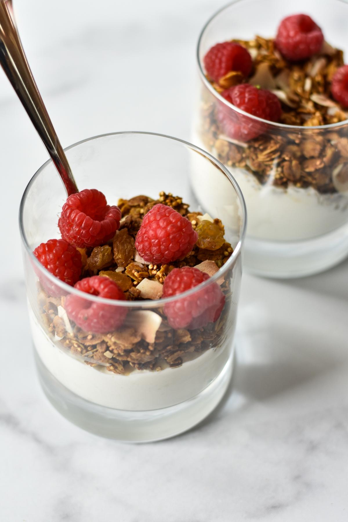 yogurt, granola and raspberries layered in glasses