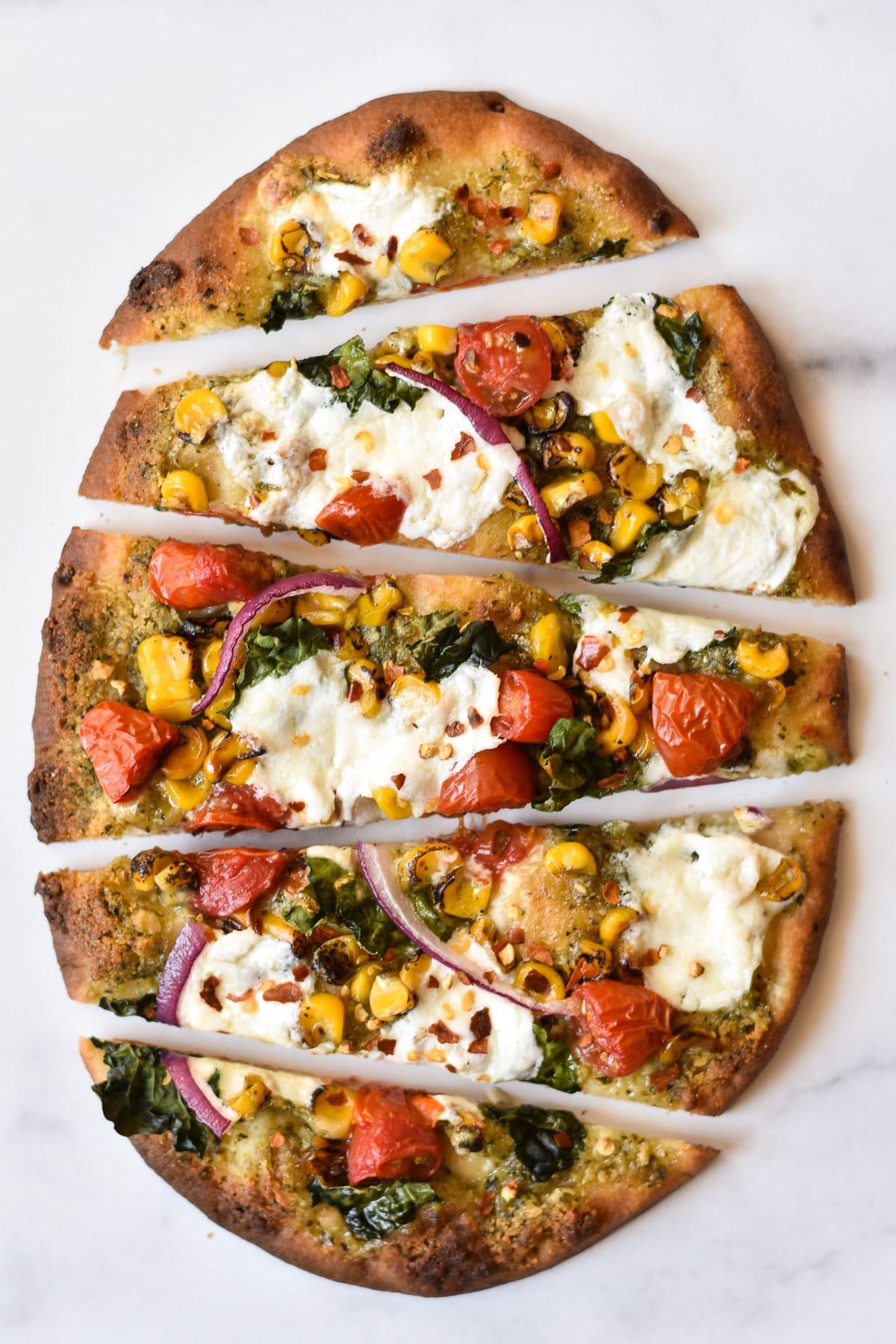 burrata naan pizza cut into wedges