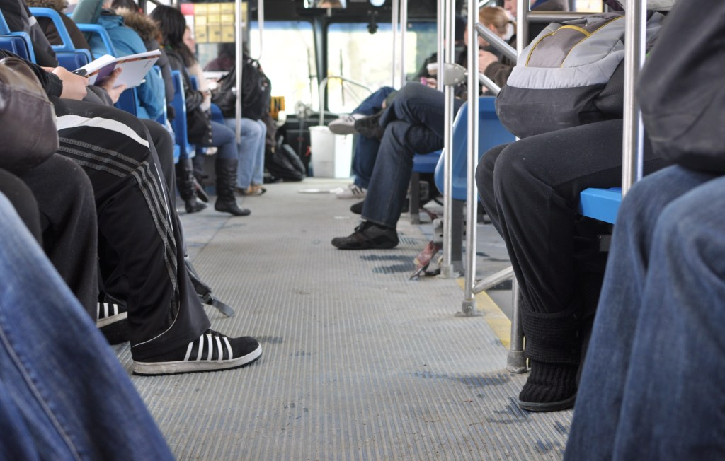 people sitting on a bus.