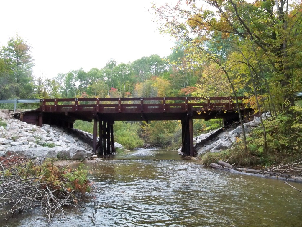 A bridge crosses a small creek.