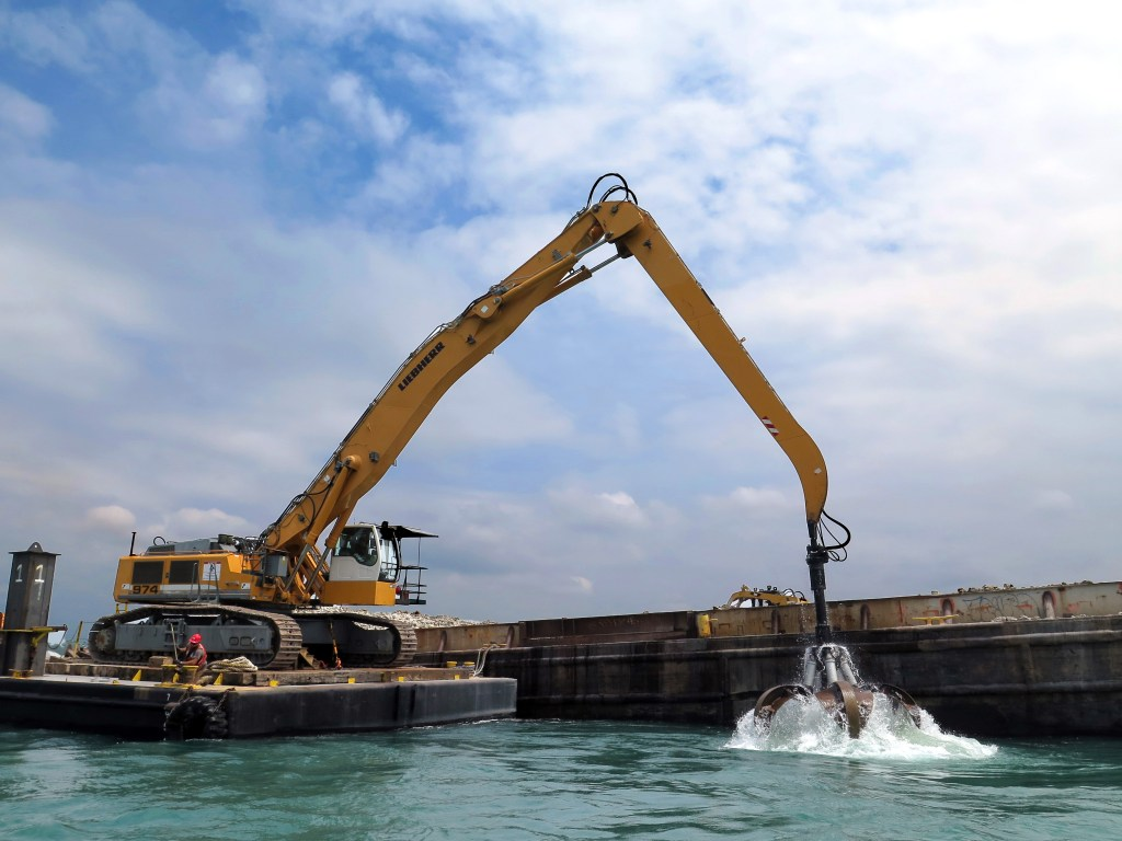 An excavator on a barge