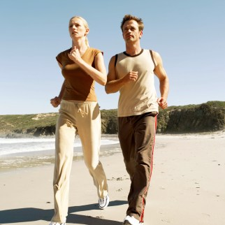 Young Couple Jogging at the Beach
