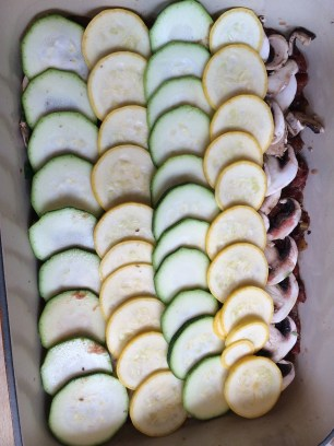 A layer of sliced zucchinni and squash