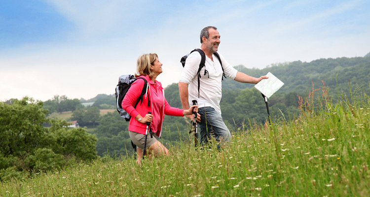 couple-walking-up-hill