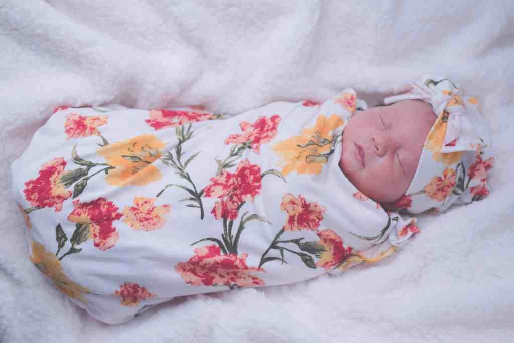 The pros and cons of newborn swaddling
