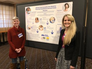 IMPLICIT Team members during the Poster Presentation Session at the March of Dimes - Florida Chapter's 2018 Prematurity Summit.   Pictured are Jamee Thumm (Project Manager) and Chelsea Arnold (IMPLICIT Coordinator from the Florida Department of Health in Sarasota County).