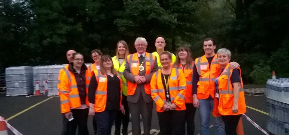 Volunteers with the Mayor of Telford handing out water to people who need it