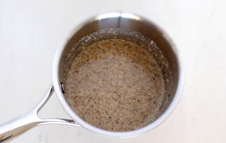 All no oats oatmeal ingredients in a stainless steel pot on a white wooden table
