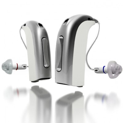 two silver hearing aids
