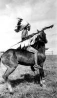Crow Man preparing, for sham battle, 1912, Crow Agency, MT