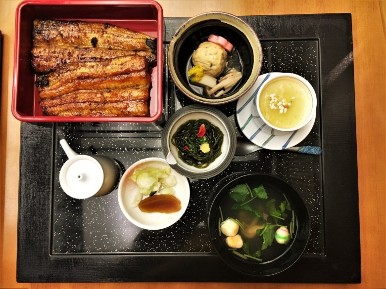An Unagi set meal, consisting of grilled eel fillets served in a set together with a clear soup