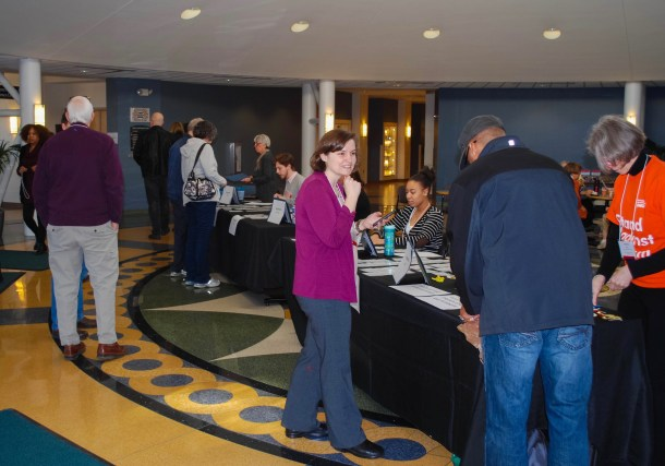 "This ""action shot"" shows Beth greeting community members as they arrive at ""Racial Justice: The Courage to Act,"" a conference in 2017 in Milwaukee, Wisconsin."