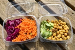 Four colorful salads. From left to right: red cabbage, carrot, cucumber, and chickpea.