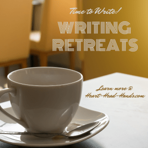 "This ad reads: ""Time to write! Writing Retreats. Learn more @ Heart-Head-Hands.com."" A white coffee mug and table appear in the foreground, with golden chairs and walls in the background."