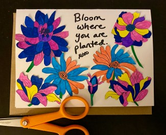 """handmade card of cut-out flowers and the saying """"Bloom where you are planted"""" (a mantra that got me through high school)"""