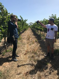 Behind the scenes shot of photographer Andre Castellucci with Brad in the vineyard.