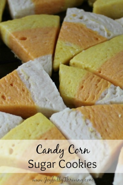 candy-corn-sugar-cookies-heres-a-simple-recipe-for-cute-little-candy-corn-cookies-its-an-easy-homemade-dough-and-then-you-just-slice-and-bake-the-cookies-what-a-fun-fall-treat-400x600