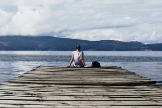 Person sits at end of dock, used on blog about new year