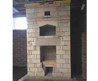 finished core of double-bell masonry heater with bake oven.  core design by Stovemaster.