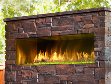 Palazzo outdoor gas fireplace with brick face