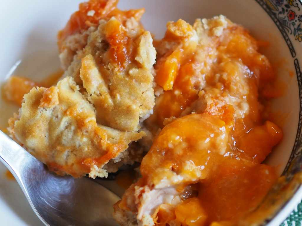 Close up of apricot cobbler, served in bowl