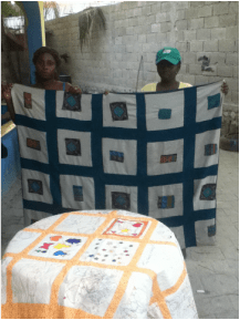 The sewing circle with a quilting creation