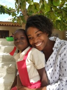 Vanessa shares a smile with a child in Corail Haiti