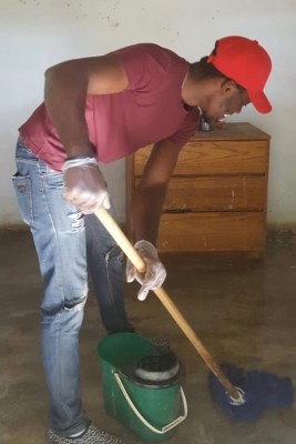Member of Heartline's outreach team cleans the home of an elderly community member