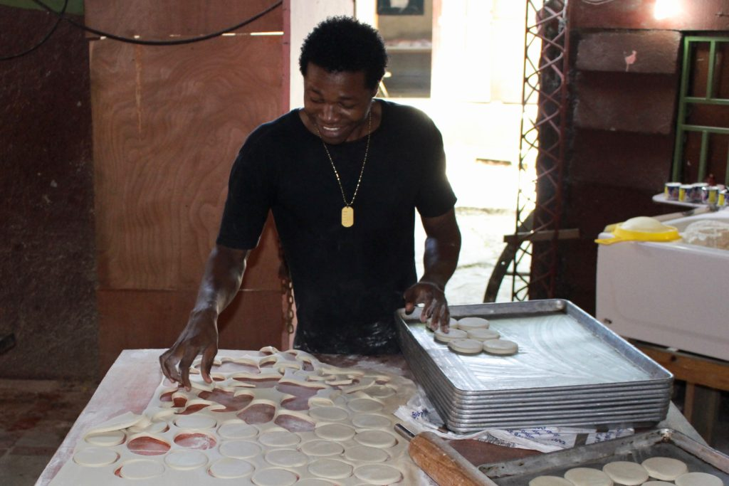 Making bread at the Heartline Beltis Bakery in Port au Prince Haiti