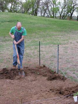 Farmer Jim, digging and planting.