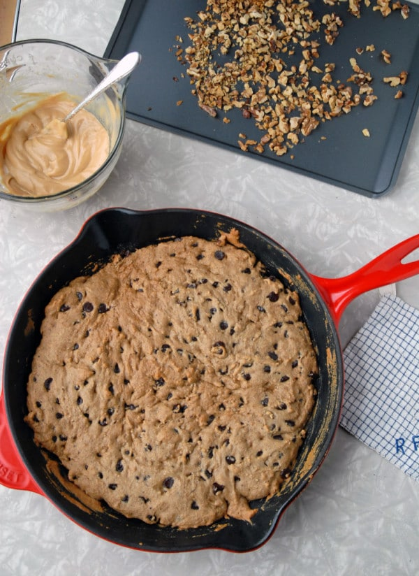 Vegan Skillet Chocolate Chip Cookie Topped with Peanut Butter Walnut Frosting