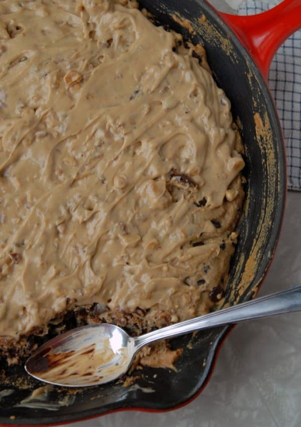 Vegan Chocolate Chip Skillet Cookie Topped with Peanut Butter Walnut Frosting