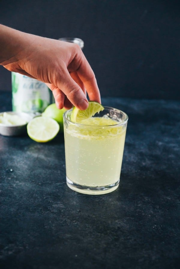 garnishing a virgin margarita with a lime wedge