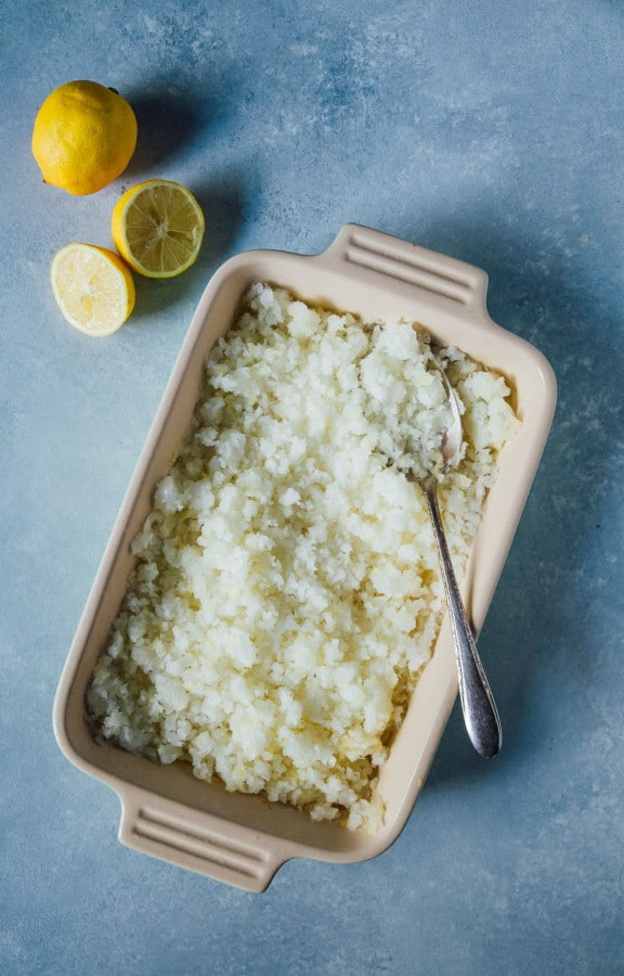 A boozy and sweet lemon lime granita, spiked with rum and loaded with tart lemon and just a bit of sweetness, perfect for a summertime treat!