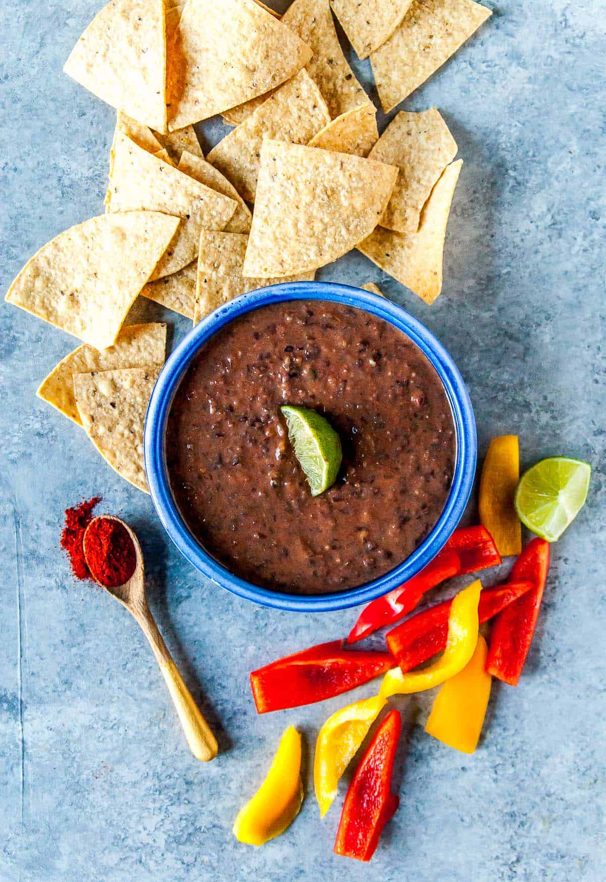 vegan black bean dip in a bowl with chips