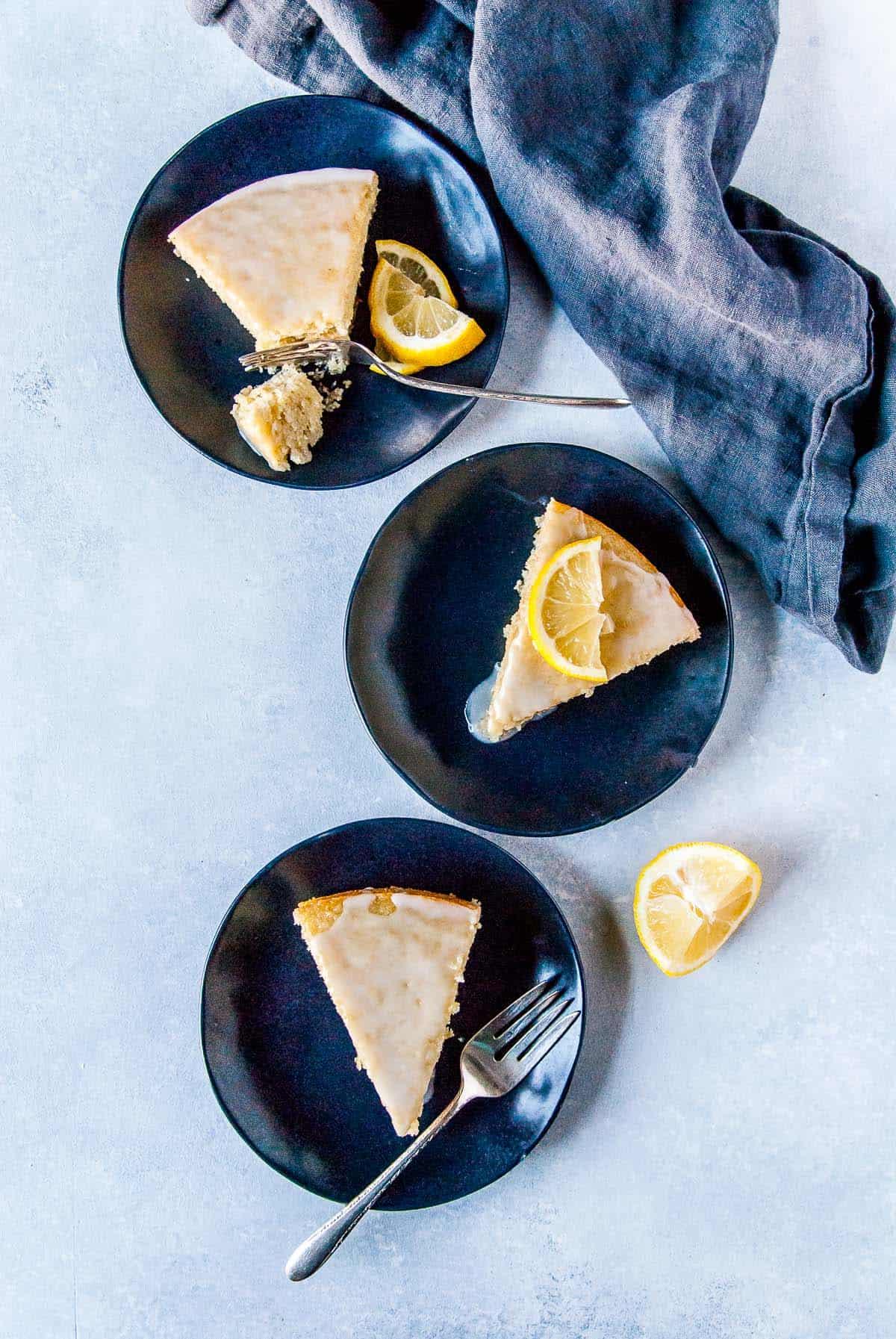 slices of vegan lemon cake on plates